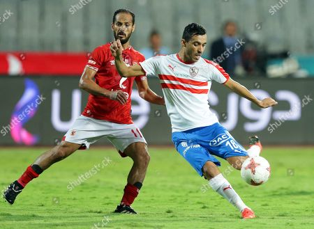Al-Ahly player Walid Soliman (L) in action against Ahly Player Marwan Mohsen during the Egyptian league soccer match between Zamalek and Al-Ahly at Borg Al-Arab Stadium in Alexandria, Egypt, 28 July 2019.