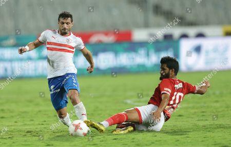Al-Ahly player Saleh Gomaa (R) in action against Zamalek player Tarek Hamed during the Egyptian league soccer match between Zamalek and Al-Ahly at Borg Al-Arab Stadium in Alexandria, Egypt, 28 July 2019.