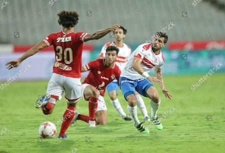 Al-Ahly player Hamdy Fathy (L) in action against Zamalek player Tarek Hamed duringg the Egyptian league soccer match between Zamalek and Al-Ahly at Borg Al-Arab Stadium in Alexandria, Egypt, 28 July 2019.