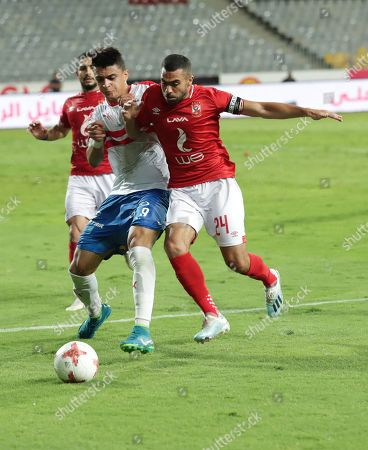 Ahly player Ahmed Fathy (R) in action against Zamalek player Omar Al-Said during the Egyptian league soccer match between Zamalek and Al-Ahly at Borg Al-Arab Stadium in Alexandria, Egypt, 28 July 2019.