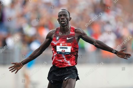 Lopez Lomong crosses the finish line as he wins the men's 5,000-meter race at the U.S. Championships athletics meet, in Des Moines, Iowa