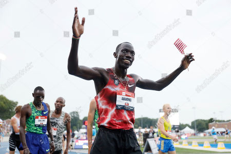 Lopez Lomong celebrates after winning the men's 5,000-meter run at the U.S. Championships athletics meet, in Des Moines, Iowa