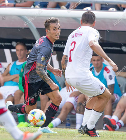Benfica defender Alex Grimaldo (L) looks to get around AC Milan defender Davide Calabria (R) during the first half of their International Champions Cup match held at Gillette Stadium in Foxboro, Massachusetts, USA 28 July 2019.
