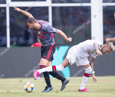 Benfica midfielder Adel Taarabt (L) and AC Milan defender Mateo Musacchio (R) battle for the ball during the second half of Benfica's 1-0 win over AC Milan in their International Champions Cup match held at Gillette Stadium in Foxboro, Massachusetts, USA 28 July 2019.