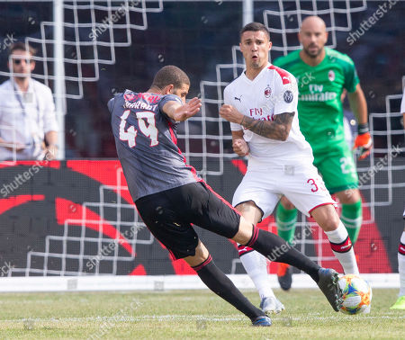 Benfica midfielder Adel Taarabt (L) shoots and scores past defending AC Milan midfielder Rade Krunic (C) and AC Milan goal keeper Gianluigi Donnarumma (R) during the second half of Benfica's 1-0 win over AC Milan in their International Champions Cup match held at Gillette Stadium in Foxboro, Massachusetts, USA 28 July 2019.