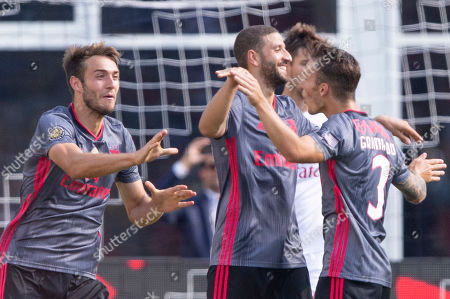 Benfica defender Ferro (L) and Benfica defender Alex Grimaldo (R) celebrate the goal by Benfica midfielder Adel Taarabt (C) during the second half of Benfica's 1-0 win over AC Milan in their International Champions Cup match held at Gillette Stadium in Foxboro, Massachusetts, USA 28 July 2019.
