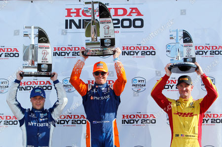 Scott Dixon, center, celebrates winning the IndyCar Series auto race at Mid-Ohio Sports Car Course with second place finisher teammate Felix Rosenqvist, left, and third place finisher Ryan Hunter-Reay, in Lexington, Ohio