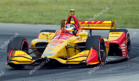 Ryan Hunter-Reay races his car during the IndyCar Series auto race, at Mid-Ohio Sports Car Course in Lexington, OH
