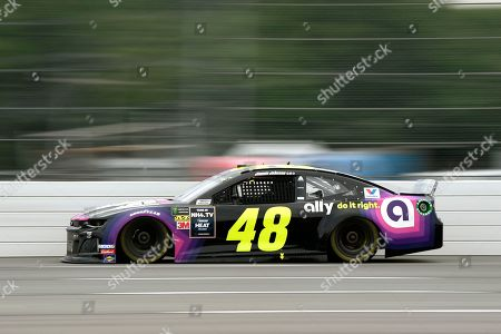 Jimmie Johnson drives down the front stretch during a NASCAR Cup Series auto race, in Long Pond, Pa