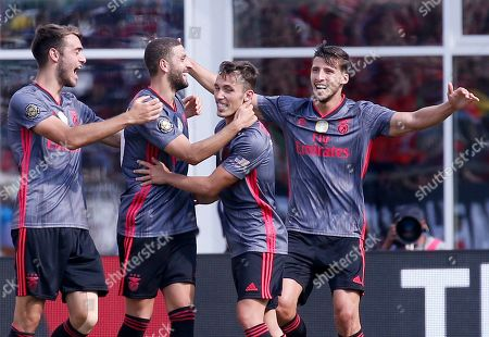 Benfica's Adel Taarabt, second from left, is congratulated by teammates after scoring a goal against AC Milan during the second half of an International Champions Cup soccer match, in Foxborough, Mass