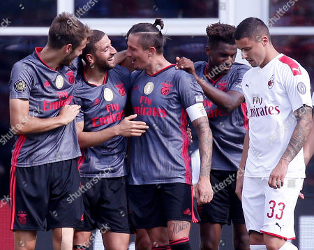 Benfica's Adel Taarabt, second from left, is congratulated by teammates after scoring a goal as AC Milan's Mattia Caldara (33) looks on during the second half of an International Champions Cup soccer match, in Foxborough, Mass