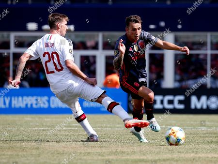 Benfica's Alejandro Grimaldo, right, moves the ball past AC Milan's Ignazio Abate during the first half of an International Champions Cup soccer match, in Foxborough, Mass
