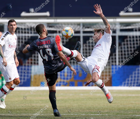 Benfica's Adel Taarabt and AC Milan's Ignazio Abate battle for the ball during the second half of an International Champions Cup soccer match, in Foxborough, Mass