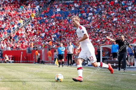 Stock Picture of AC Milan's Ivan Strinic dribbles the ball during the second half of an International Champions Cup soccer match against Benfica, in Foxborough, Mass