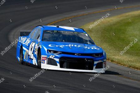 Kyle Larson (42) drives through Turn 3 during a NASCAR Cup Series auto race, in Long Pond, Pa. Denny Hamlin won the race