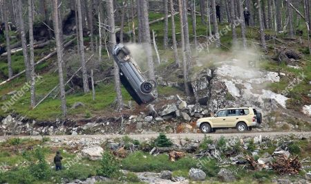 Crash scene being filmed for the new James Bond movie at Ardverikie Estate in the Highlands where a Range Rover is forced off the road by another 4x4.