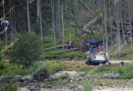 Stock Picture of Crash scene being filmed for the new James Bond movie at Ardverikie Estate in the Highlands where a Range Rover is forced off the road by another 4x4.