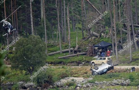 Stock Photo of Crash scene being filmed for the new James Bond movie at Ardverikie Estate in the Highlands where a Range Rover is forced off the road by another 4x4.