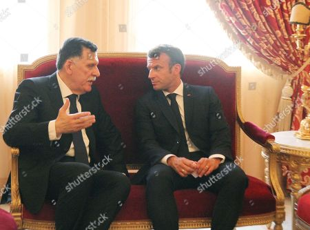 French President Emmanuel Macron (R) speaks with Libya's UN-recognised Prime Minister Fayez al-Sarraj (L) during late Tunisian president Beji Caid Essebsi's state funeral at the presidential palace