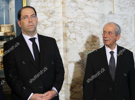 The interim Tunisian President Mohamed Ennaceur (R) and Tunisian Prime Minister Youssef Chahed attend during the state funeral of late Tunisian president Beji Caid Essebsi at the Presidential Carthage Palace in Tunis