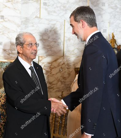 Stock Photo of King Felipe VI (R) shakes hands with interim Tunisian president Mohamed Ennaceur during the state funeral of late president Beji Caid Essebsi at the presidential carthage palace in Tunis