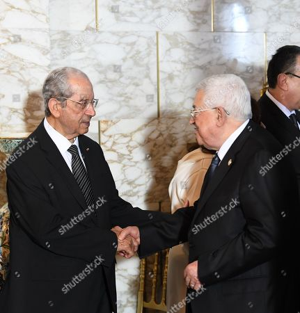 Palestinian President Mahmoud Abbas shakes hands with interim Tunisian president Mohamed Ennaceur (L) during the state funeral of late president Beji Caid Essebsi at the presidential carthage palace in Tunis