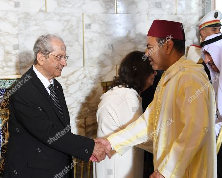 Prince Moulay Rachid of Morocco (R), brother of Morocco's King Mohammed VI, shakes hands with interim Tunisian president Mohamed Ennaceur (L) during the state funeral of late Tunisian president Beji Caid Essebsi at the presidential carthage palace in Tunis