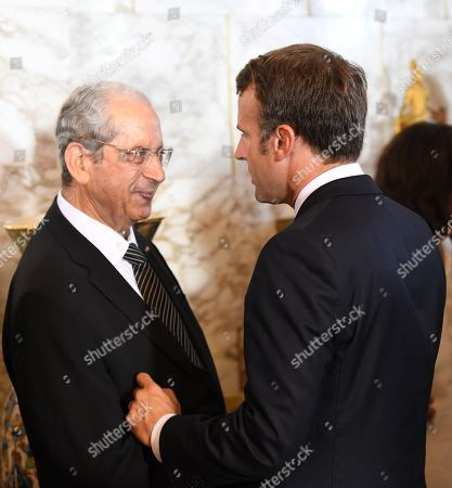 Stock Picture of French President Emmanuel Macron (R) speaks with interim Tunisian President Mohamed Ennaceur (R) during the state funeral of late Tunisian president Beji Caid Essebsi at the presidential palace