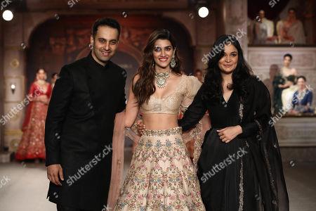Kriti Sanon with designer duo Shyamal and Bhumika on the catwalk