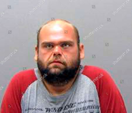 """This undated photo provided by the Hot Springs Police Department shows Jonathan Scott. Authorities in Arkansas say Scott, who was seen """"pumping a gun"""" in a busy tourist area, is in critical condition after he was shot by police. Hot Springs police say several people called 911 to report a man walking along Bathhouse Row while carrying a long gun and threatening bystanders . Officers responded and exchanged gunfire with Scott, and one police officer was struck twice. The officer was treated and released from a hospital"""