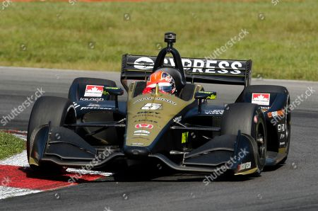 James Hinchcliffe races his car during the IndyCar Series auto race, at Mid-Ohio Sports Car Course in Lexington, OH