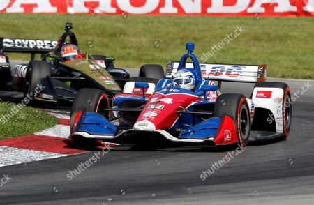 Tony Kanaan races his car during the IndyCar Series auto race, at Mid-Ohio Sports Car Course in Lexington, OH