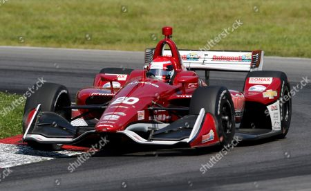 Ed Jones races his car during the IndyCar Series auto race, at Mid-Ohio Sports Car Course in Lexington, OH