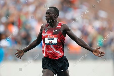 Stock Picture of Lopez Lomong crosses the finish line as he wins the men's 5,000-meter run at the U.S. Championships athletics meet, in Des Moines, Iowa