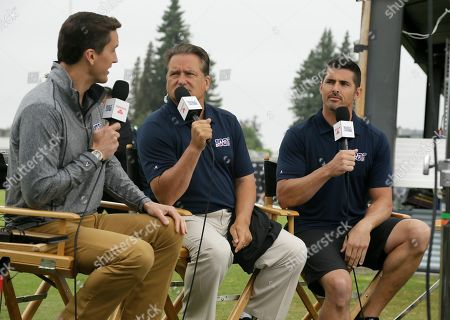 NFL network analyst David Carr, right, with host Rhett Lewis, left, and analyst Steve Mariucci, center, during the Oakland Raiders football training camp, in Napa, Calif