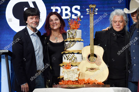 "Ken Burns, Rosanne Cash, Marty Stuart, Dwight Yoakam. Ken Burns, far left, director of the upcoming PBS documentary series ""Country Music,"" is presented with a birthday cake by, from left, country music performers Rosanne Cash, Marty Stuart and Dwight Yoakam following a panel discussion on the series at the 2019 Television Critics Association Summer Press Tour at the Beverly Hilton, in Beverly Hills, Calif"