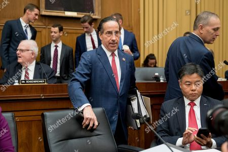 Members of the House Judiciary Committee including Rep. Jamie Raskin, D-Md., center, and Rep. Ted Lieu, D-Calif., bottom right, arrive to hear former special counsel Robert Mueller, accompanied by his top aide in the investigation Aaron Zebley, testify before the House Judiciary Committee hearing on his report on Russian election interference, on Capitol Hill, in Washington