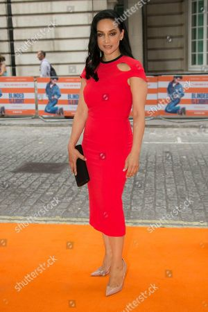 Stock Image of Archie Panjabi poses for photographers upon arrival at the screening for Blinded By The Light, in London