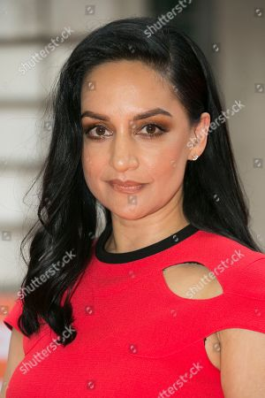 Archie Panjabi poses for photographers upon arrival at the screening for Blinded By The Light, in London