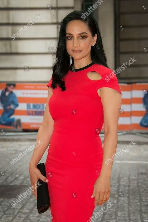 Stock Photo of Archie Panjabi poses for photographers upon arrival at the screening for Blinded By The Light, in London