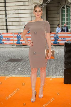 Stock Photo of Amanda Clapham poses for photographers upon arrival at the screening for Blinded By The Light, in London