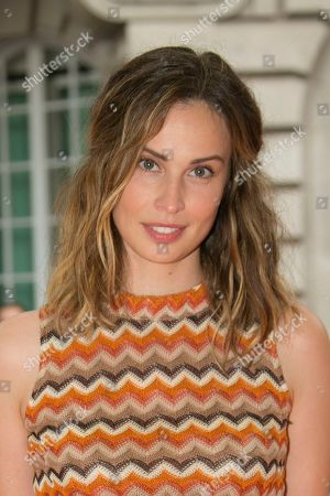 Heida Reed poses for photographers upon arrival at the screening for Blinded By The Light, in London