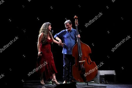 Spanish bass player Javier Colina (R) and Spanish singer Silvia Perez Cruz (L) perform on stage accompanied by Brazilian singer and composer Toquinho (not pictured) during their concert in the framework of the Universal Music Fest at the Spanish Royal Theater in Madrid, Spain, 29 July 2019.