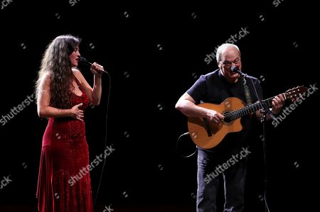 Stock Photo of Silvia Perez Cruz (L) and Brazilian singer and composer Toquinho (R) perform on stage during their concert in the framework of the Universal Music Fest at the Spanish Royal Theater in Madrid, Spain, 29 July 2019.