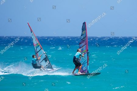 Stock Image of Italy's Matteo Iachino (L) and France's Antoine Albeau (R) in action during the Windsurfing World Championships slalom trial in Fuerteventura, Canary Island, Spain, 29 July 2019.