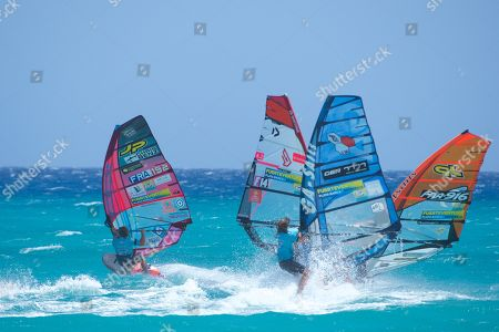 France's Antoine Albeau (L) action during the Windsurfing World Championships slalom trial in Fuerteventura, Canary Island, Spain, 29 July 2019.