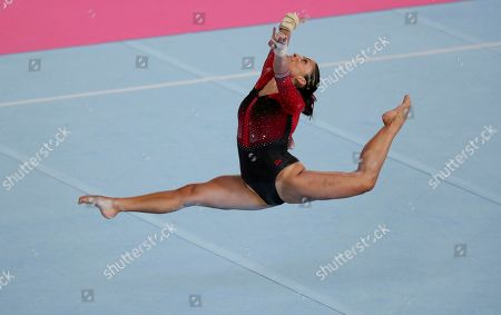 Sandra Collantes of Peru performs her floor routine in the women's individual all-around artistic gymnastics event at the Pan American Games in Lima, Peru