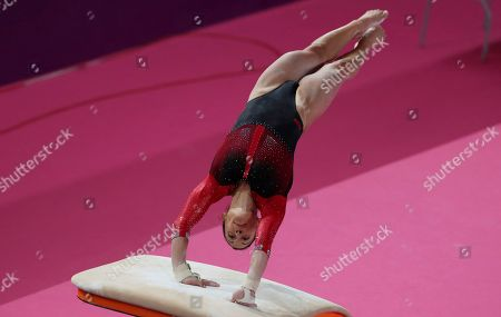 Sandra Collantes of Peru competes on vault in the women's individual all-around artistic gymnastics at the Pan American Games in Lima, Peru