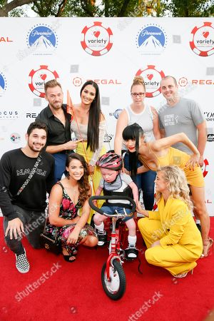 Alan Bersten, Victoria Arlen, Artem Chigvintsev, Nikki Bella, Bail Ling and AnnaLynne McCord with Zachary and his parents