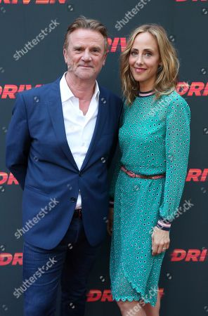 """Nick Hamm, Kim Raver. Director Nick Hamm, left, and Kim Raver attend the LA Premiere of """"Driven,"""" at the ArcLight Hollywood, in Los Angeles"""
